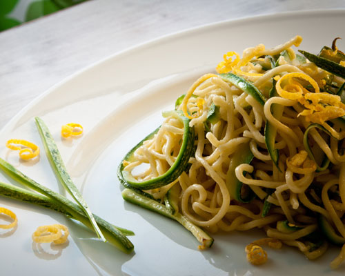 Spaghetti served with butter, lemon and courgette sauce